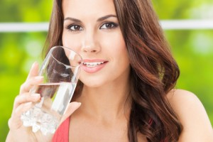 Young woman drinking water, outdoor